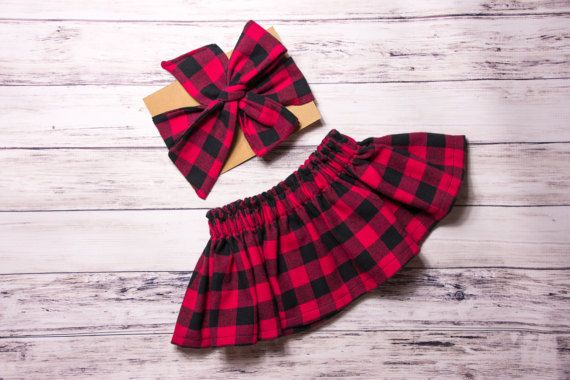 This red buffalo plaid skirt and head wrap set is perfect to dress up your little girl for the winter holidays! Its perfect for Christmas or just for a winter season photo shoot! This skirt is made of a flannel fabric and it is thicker than plain cotton fabric, perfect for winter time!  Headwrap- tieable bow as shown in the first photo Bow Clip- a bow on an alligator clip Bow Headband- a bow on a black nylon band Bow Tie- made to clip on to a little boys bodysuit or t-shirt  Matching Romper…