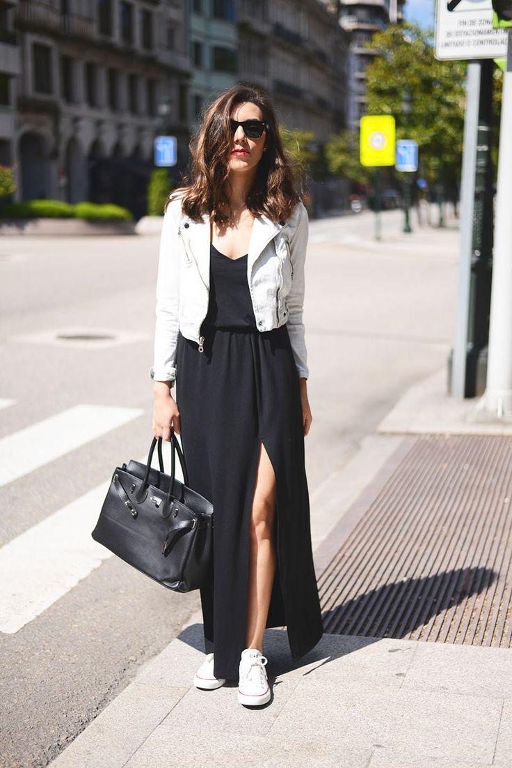 Street style. Maxi black dress. White jacket. White converse. Black bag.