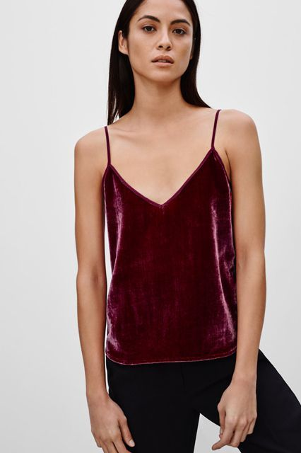 Just because the holiday season is over doesn't mean it's time to pack up the red velvet entirely. This spaghetti-strapped tank is super simple, meaning its versatility is off the charts. How good would this look under a borrowed-from-the-boys blazer? Or a leopard faux-fur jacket?Talula Arcade Camisole, $60 $19.99, available at Artizia. #refinery29 http://www.refinery29.com/2016/01/102209/going-out-tops-alexa-chung#slide-1