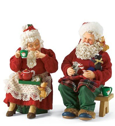 Kittens and Cocoa--Santa and Mrs. Claus sit down for some cocoa and cookies while their little kittens playfully crawl on them. Mrs. Claus giggles with delight as one kitten climbs up her apron as she sips from her Santa mug.