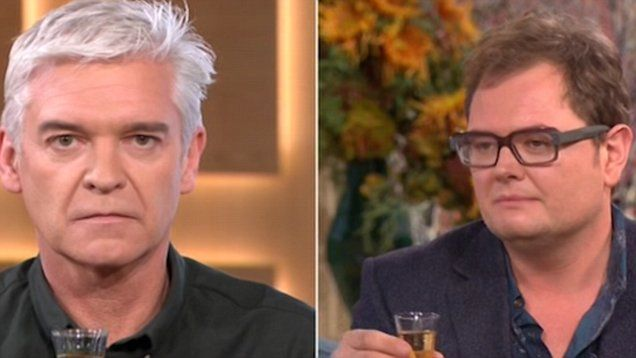 Alan Carr was a guest on 'This Morning' today, and Philip Schofield challenged him to a drinking game, where the winner had to keep a straight face for the longest. Watch to see the results!