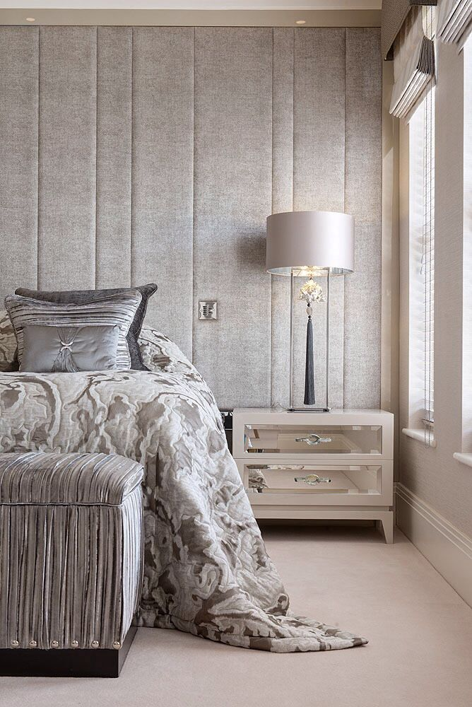 Luxurious upholstered headboard wall with vertical panels, bespoke lacquer and mirror bedside and beautiful bedding © Hill House Interiors