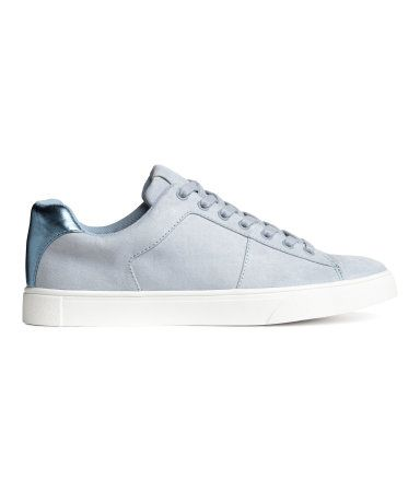 Light grey blue. Sneakers with lacing at front. Mesh lining, mesh insoles, and rubber soles.