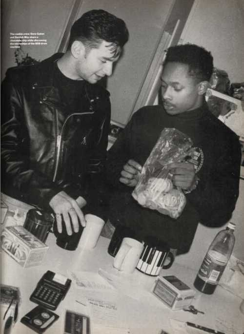 "Detroit techno pioneer Derrick May with Depeche Mode lead singer Dave Gahan. ca. 1989 ""They've set the standard in what they do. In America they've been able to please almost everyone, from a guy like me who's a hardcore dance addict, to the stadium crowds. They're right on time, right in synch, and they can't even help it."" -Derrick May on Depeche Mode"