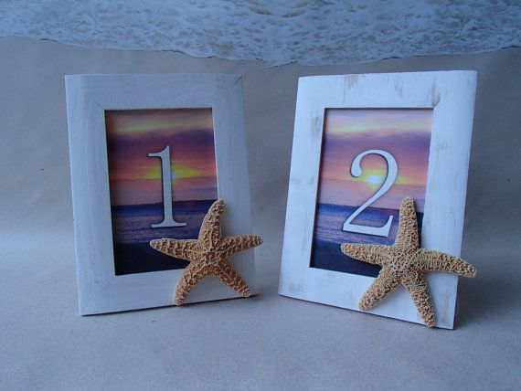 Starfish Sunset Beach Table Numbers with frames. Each table number is printed with a beautiful sunset beach background and includes a white