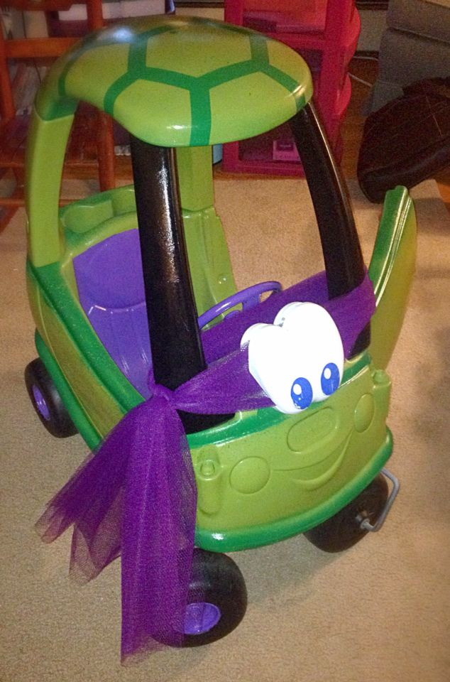Custom Little Tikes Cozy Coupe outfitted as TMNT Donatello. Saw similar designs and put my own touches on it. For my first ever project with spray paint it came out better than I expected. My niece couldn't have been happier to get this for her first birthday. Started by breaking down and sanding the whole car with fine grit sandpaper. Taped off the needed areas (wheels, seat, roof pattern). Then wrapped the tires in plastic bags, and sprayed each component and allowed to dry for 2-3 coats…