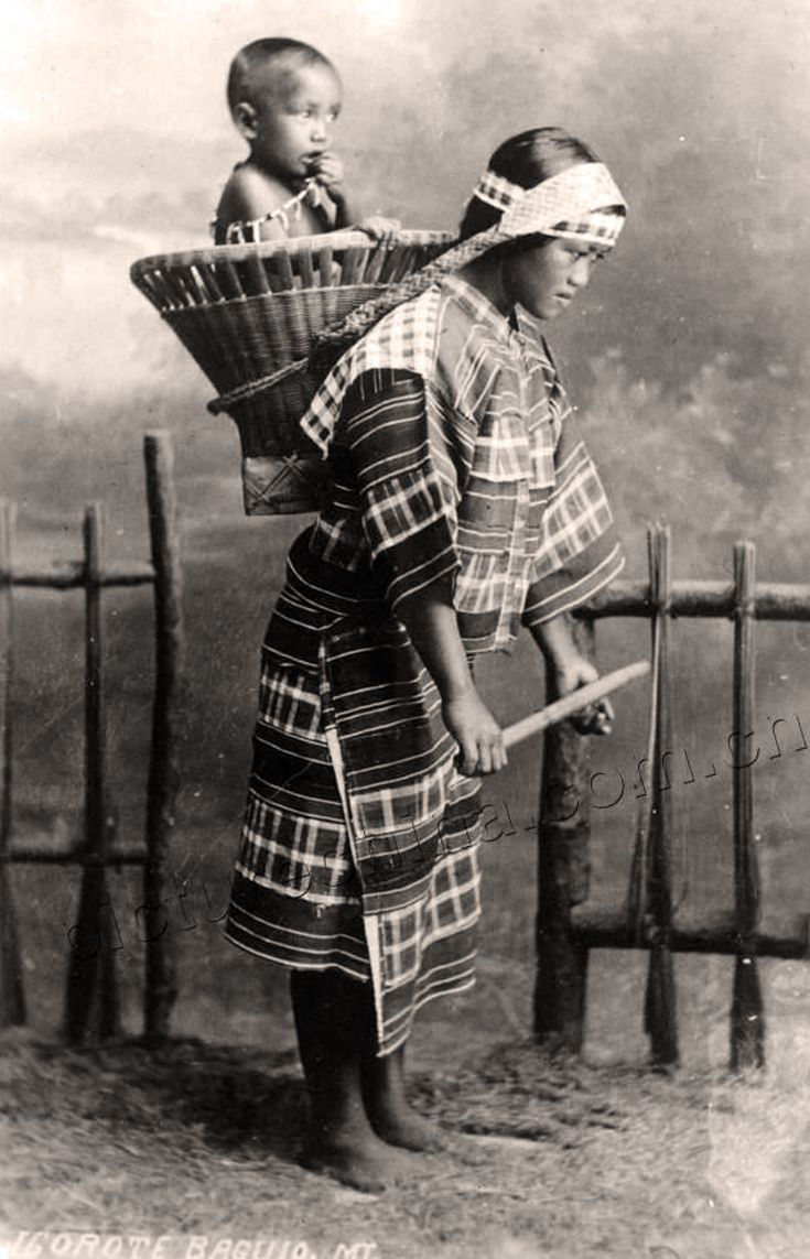 Philippines Igorote Woman Carrying Her Child In A Basket