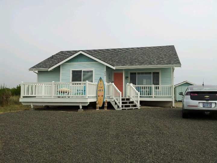 Our beach house exterior repainted! !  A little beach cutey  .Colors are Drizzle, Tidewater, Alabaster, Ravishing Coral