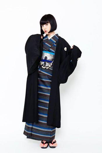 Woman in Japanese kimono, obi, and haori.