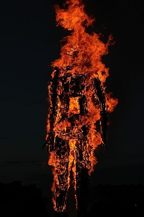 Anthony Gormley - Waste Man, a giant man made from spare waste pieces of wood and wooden objects, and then lit on fire.