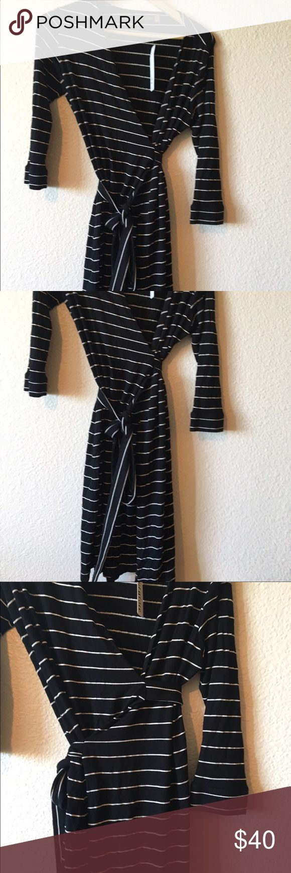 Revolve Black Dress , Saint Grace brand Size M Size m Black and white wrap very lightweight sweater dress new with tags size medium bought from revolve clothing website - saint grace brand size m , hits At knee! Great for graduations , with a sexy flare saint grace Dresses