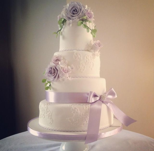 Lavender and lilac rose wedding cake with patches of piped lace by The Pretty Cake Company