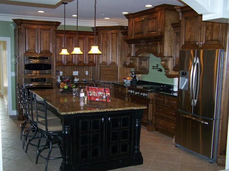 This kitchen has a stain and glaze on alder wood with a painted and weathered black on the island.
