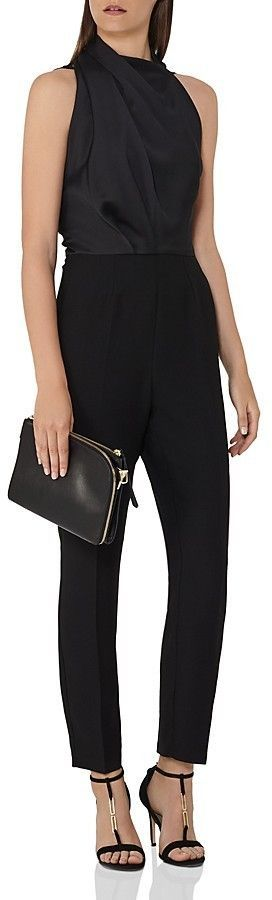 REISS Kita Lace-Back Cropped Jumpsuit    REISS gives the trending cropped jumpsuit an elegant touch with a draped neckline and adds a daring twist with a sheer lace back, an elevated, so-today look that makes for a stunning exit.Fits true to size. affiliate