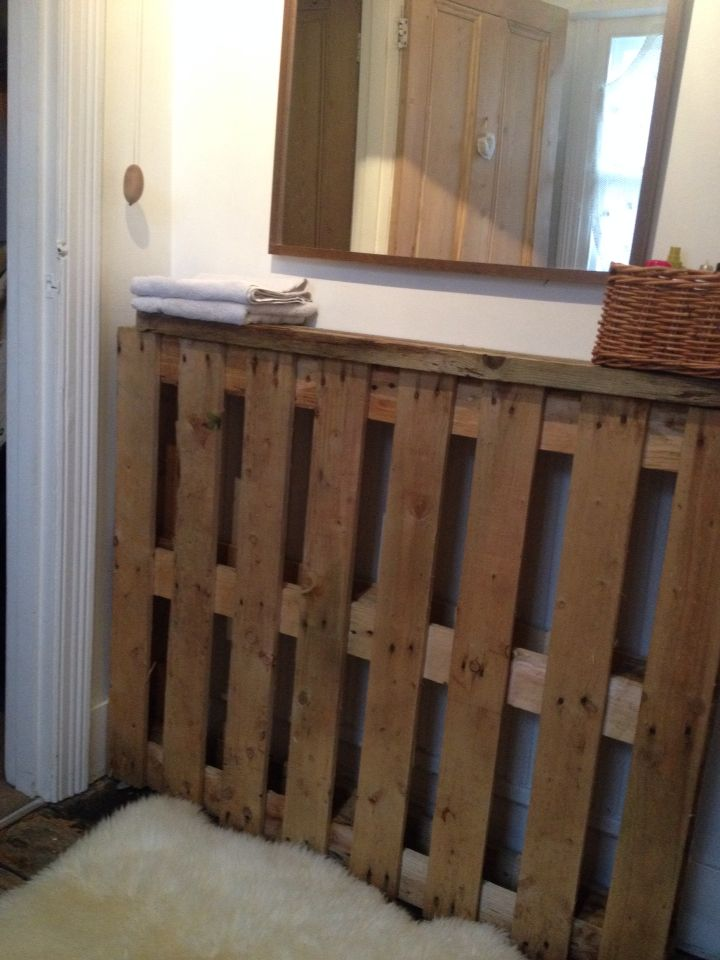 I used a pallet as a radiator cover/shelf in the bathroom
