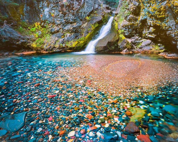 """Polychrome Pool"", Three Sisters Wilderness, Central Oregon. This enchanted little pool, located high in the Three Sisters Wilderness Area of Central Oregon, has the most colorful collection of rock of any I've seen in the state of Oregon! Photogenic waterfalls, transparent, blue tinted pools, and the aforementioned stream rocks make for a stunning art photograph …"