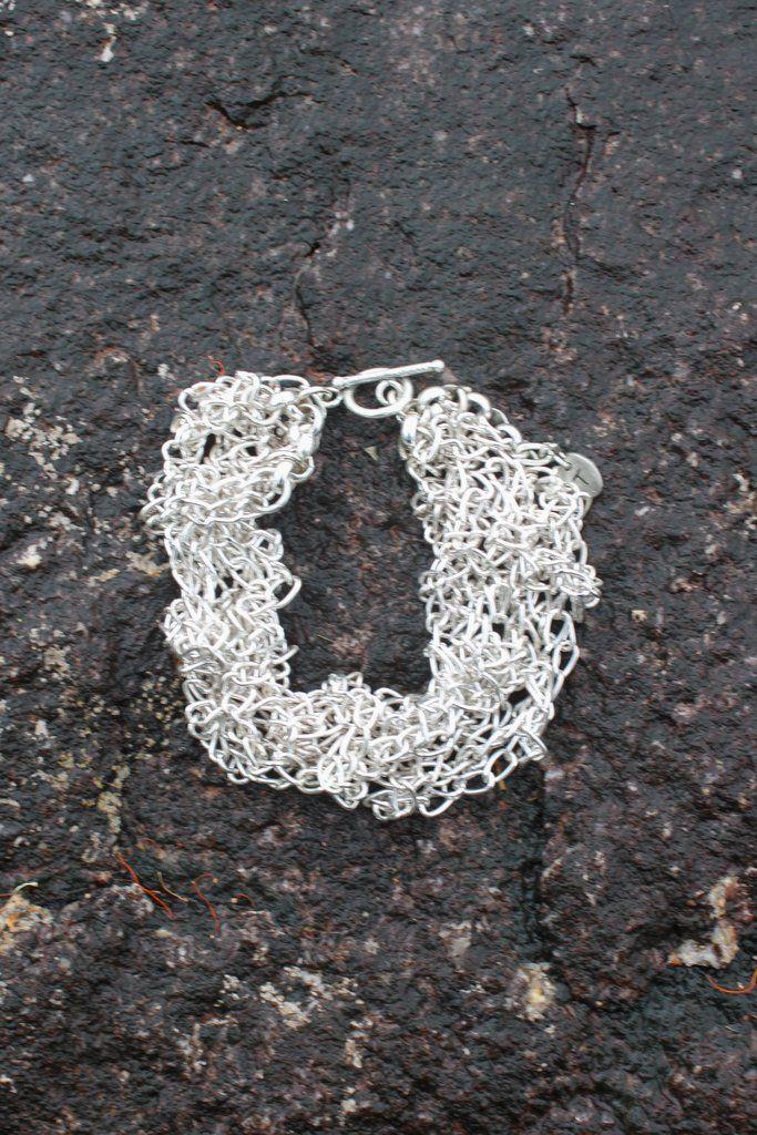 Silver hand knitted bracelet