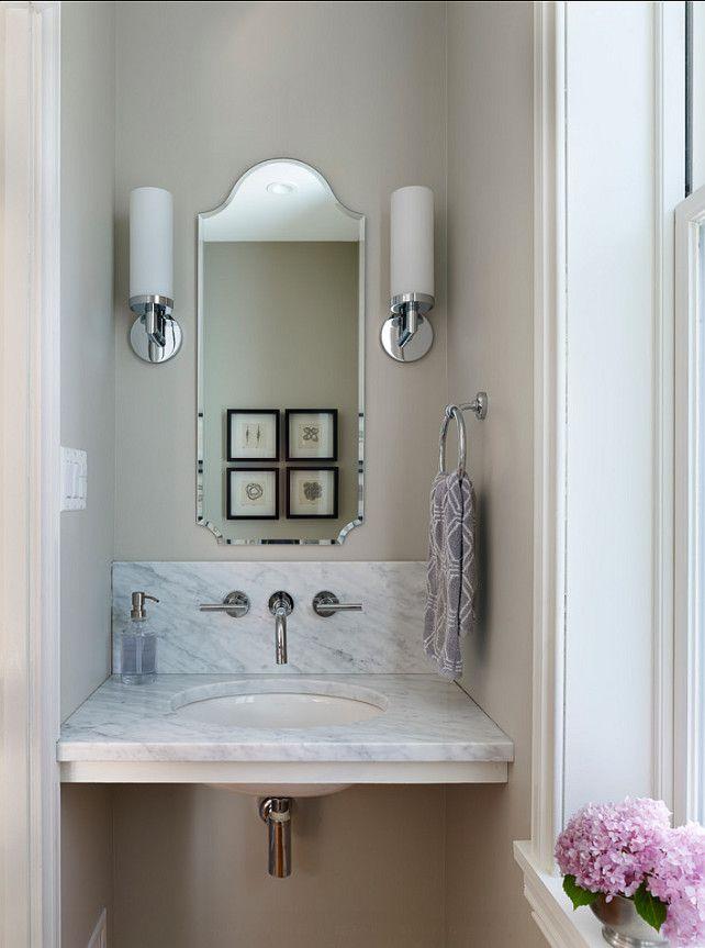 narrow bathroom mirror with cylinder sconces