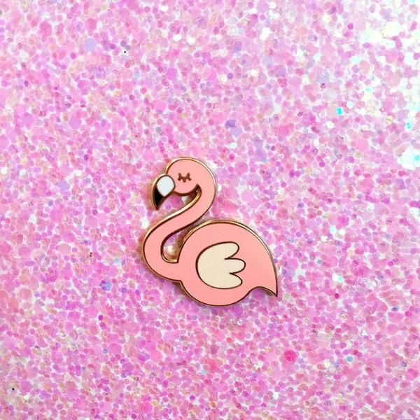 """Flamingo hard enamel lapel pin. Smooth hard enamel with gold trim. Comes with a soft rubber pin back. Pin this to your favorite jacket, bag, sweater, etc Measures 1"""" tall"""