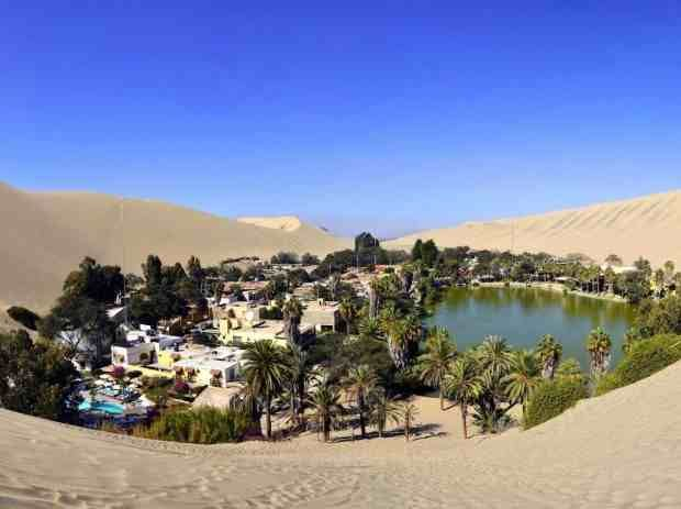 Huacachina, Peruvian desert Huacachina is a tiny village of just over 100 people built around a lush oasis in an otherwise barren desert. For a few bucks, you can rent sandboarding equipment and try one of the locals' favorite thrills.