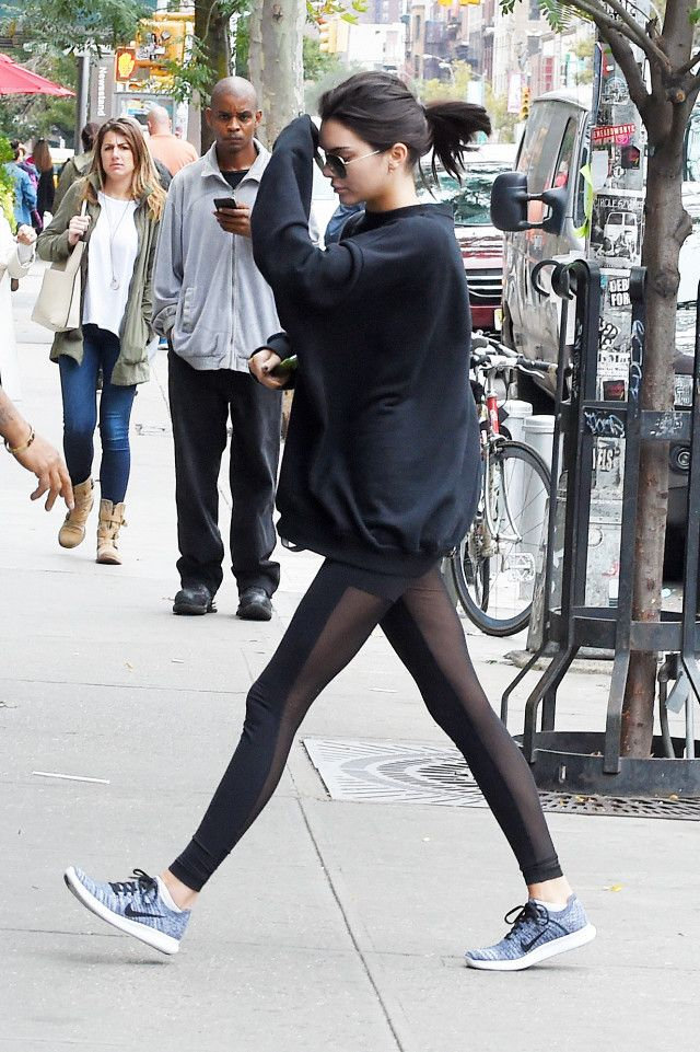 Kendall Jenner wearing leggings and Nikes