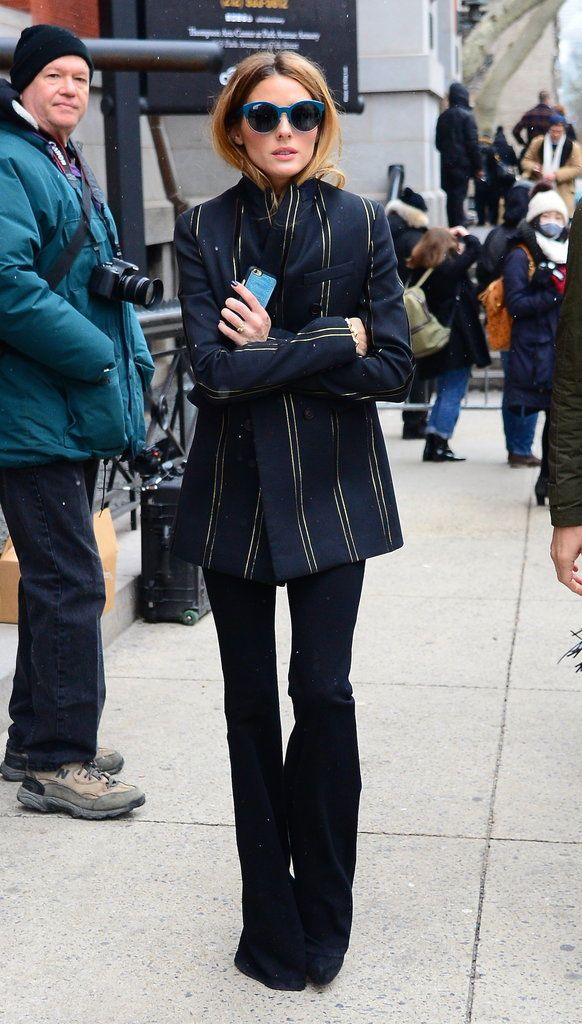 Olivia outfitted flares with a striped blazer for a '70s moment outside the Tommy Hilfiger show. Image Sour...