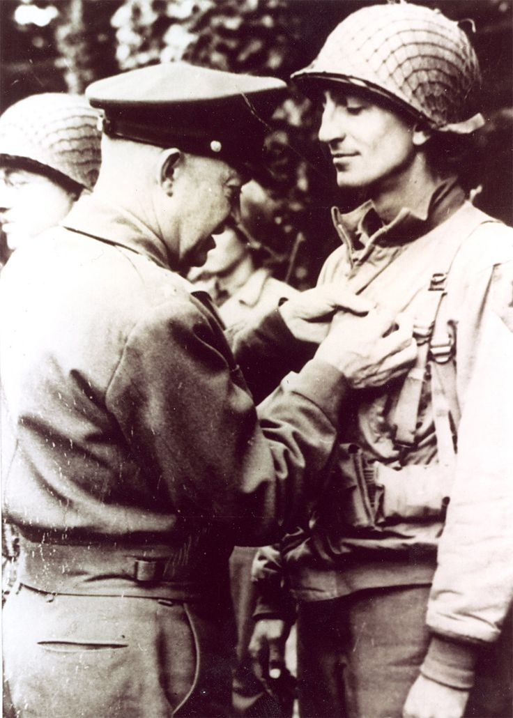 "Captain Joseph T. Dawson helped stave off German counterattacks at Aachen. ""These bitter tragic months of terrible war leave one morally as well as physically exhausted,"" he told his family. Here Dawson receives the Distinguished Service Cross from Eisenhower for heroics at Omaha Beach. (McCormick Research Center, First Division Museum)"