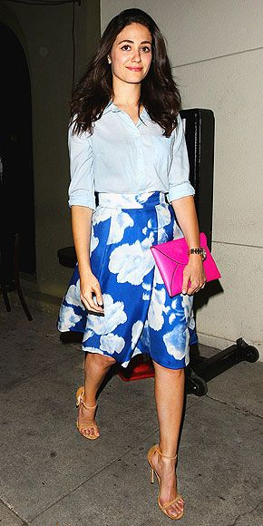 10 Street Style Superheroes of 2014 | EMMY ROSSUM | Whenever the Shameless star steps out, she embodies casual and ladylike style – think modern A-line cuts (like this CH Carolina Herrera skirt), bold florals, polished blouses,and leg-lengthening heels.
