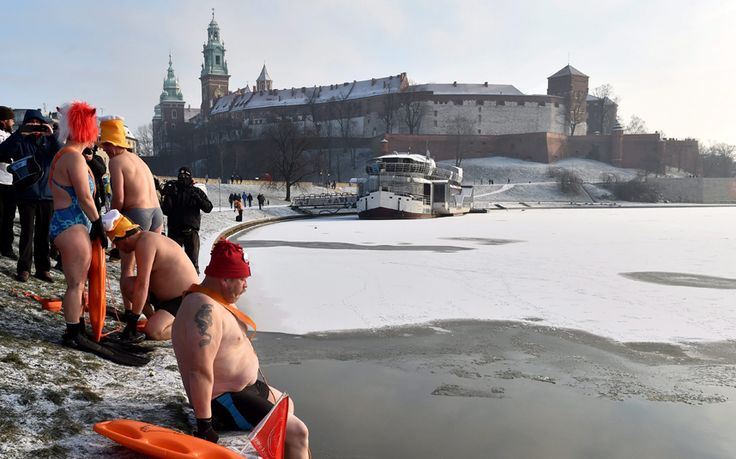Cold weather enthusiasts, called Walruses, swim in the Wistula river as temperatures fell to minus 15 degrees Celsius, near the Wawel Castle in Krakow, Poland