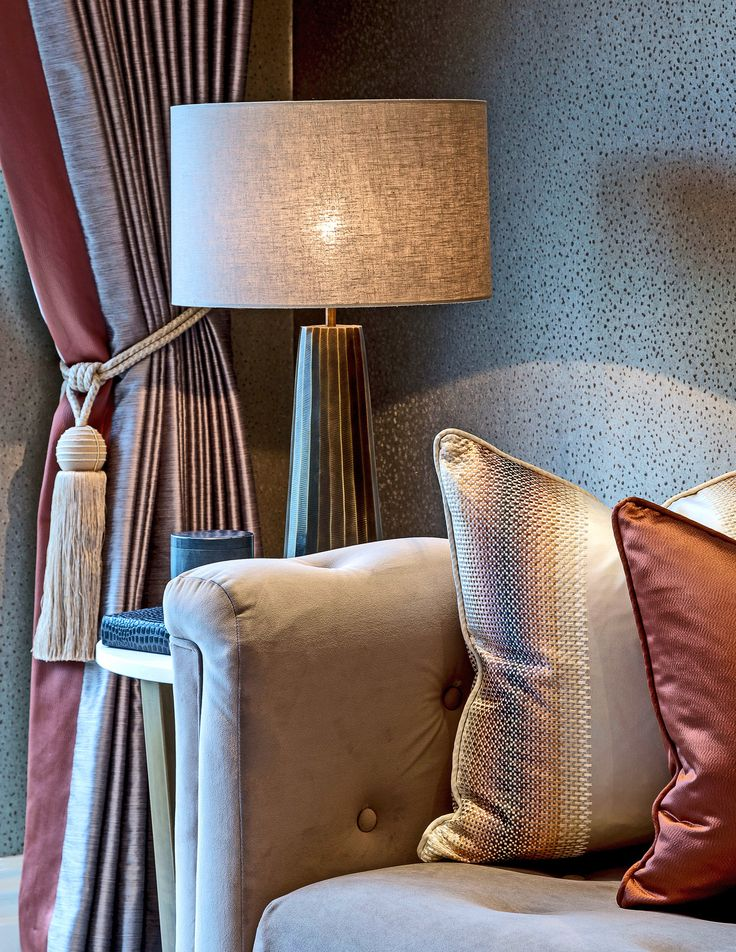 Sleek and luxuriously indulgent, these Villa Nova cushions add another layer of glamour to our riverside living room design, perfectly complemented by the stylish wallpaper behind.