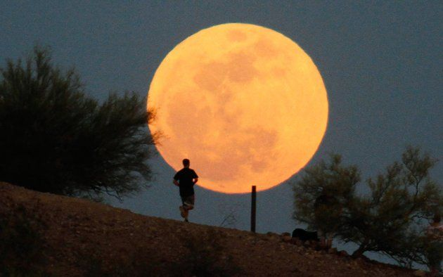 """A runner makes his way along a trail on a butte in front of the """"supermoon""""  at Papago Park in Phoenix, Arizona May 5, 2012. A """"supermoon"""" will light up Saturday's night sky, May 5, in a once-a-year cosmic show, overshadowing a meteor shower from remnants of Halley's Comet, the U.S. space agency NASA said. The Moon will seem especially big and bright since it will reach its closest spot to Earth at the same time it is in its  full phase, NASA said.: Phoenix Arizona, Beautiful Moon, Super Moon, Full Moon, Night Sky, Saturday Night, Parrot Parks, Moon Pictures, The Moon"""