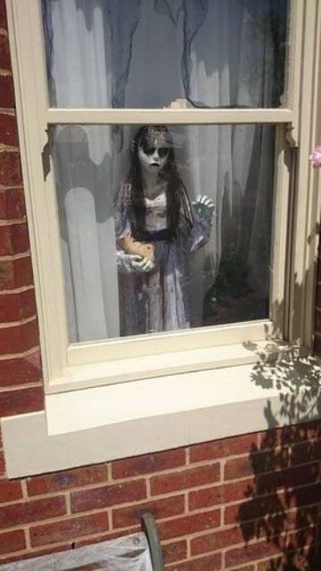 Give passers by a real fright with ghastly figures from your favorite horror movies perched in the window. Make the illusion complete with sheer drapes behind and colored lighting in red shining on the character.