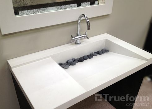 formed concrete as an option for a contemporary, low maintenance look for guest bathrooms.  http://www.trueformconcrete.com/custom/wp-content/gallery/sinks/concrete-sink-104.jpg