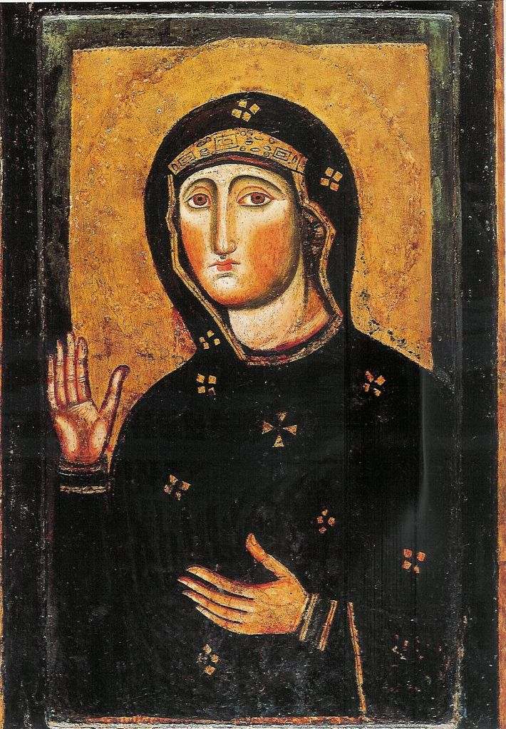 Madonna Avvocata / Our Lady the Advocate in the Basilica di Santa Maria in Ara coeli al Campidoglio, Roma.   The icon attributed to St. Luke the Evangelist, originated from Jerusalem, by way of the Chalkoprateia Church of the Theotokos in Constantinople, to Rome in the 400s. The present image is a copy, dated to the late 1000s. It is an icon of the Hagiosoritissa type, showing Maria without child, her hands in an intercessory gesture: the Madonna Avvocata.