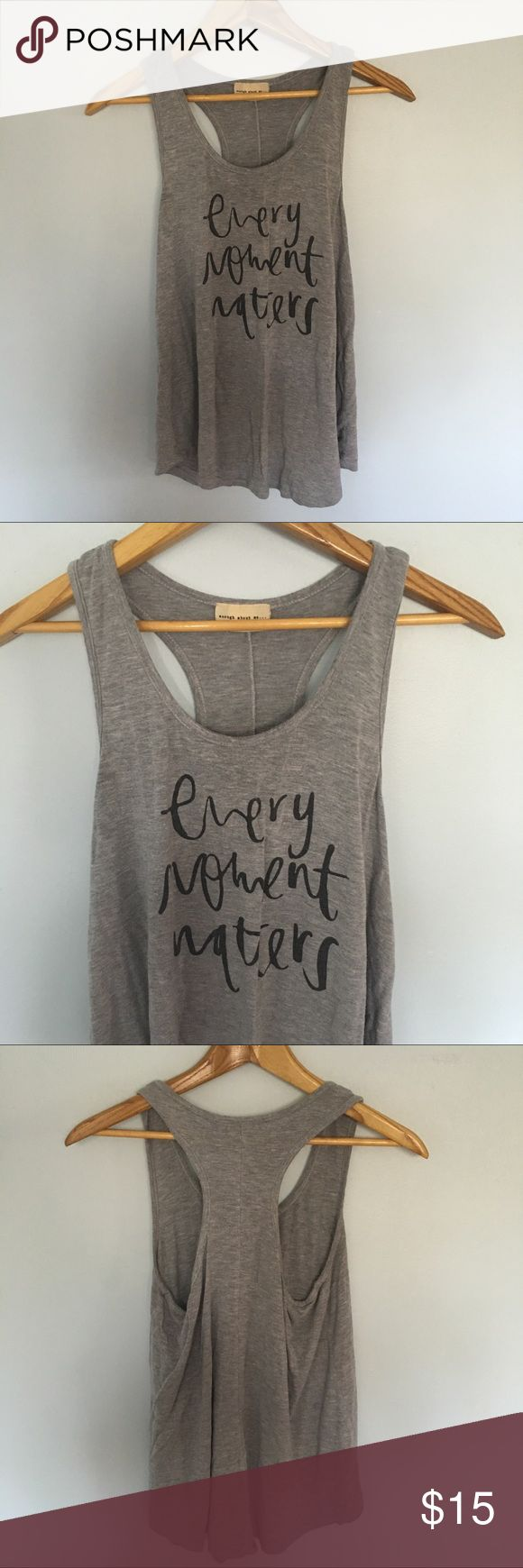 """Every Moment Matters"" Graphic Racerback Tank Top Previously well loved tank top. Cozy and comfy! Perfect in its own or layered. enough about me... Tops Tank Tops"