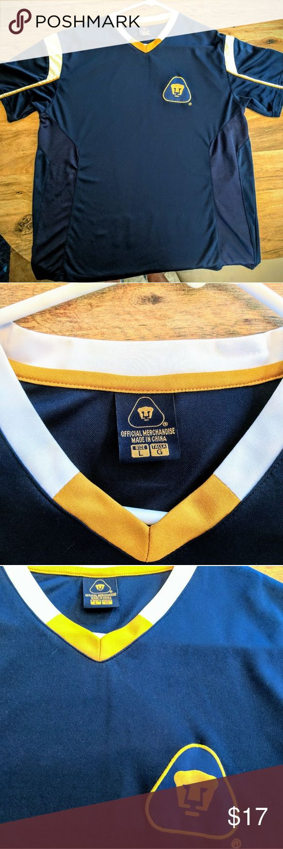 "Pumas UNAM Mexico ""FMF Oficial"" Soccer Jersey L Beautiful PUMAS UNAM Mexico FMF Soccer Jersey!  Jersey features UNAM PUMAS logo on upper right of chest, FMF Division 1a Oficial Patch on Left Sleeve.  On the lower back features large ""PUMAS"" in gold writing with Pumas UNAM logo in top center of the back.     Jersey is Size Large dark blue, with gold and white sleeve design and collar.  Athletic Cut Easy-Breathe material in mid-section.       Jersey is in perfect flawless condition, worn once…"