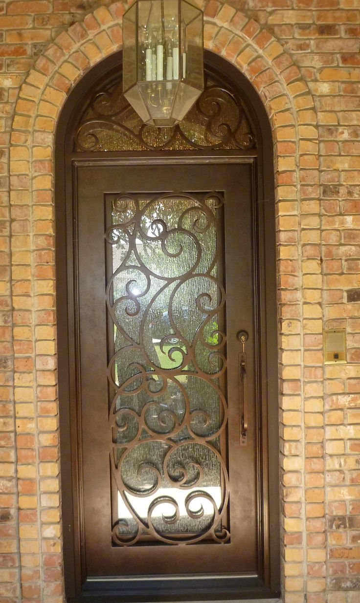 Swirly design single iron door transom for Door design of iron