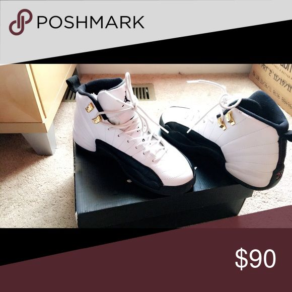 Jordan 12 retros black and white taxis Black and white Jordan taxis retro 12s. Great condition. Jordan Shoes Sneakers