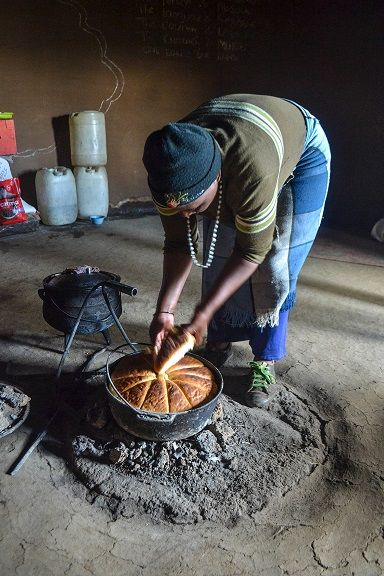 Basotho Village, Lesotho - Matitso sharing freshly baked bread with us