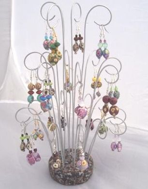 Eye catching earring display made from artistically curved wires in a polymer clay base. Will make a beautiful display for shows, or in your home!