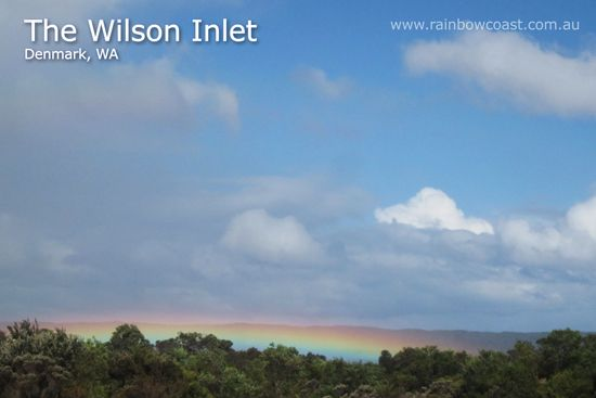 The Wilson Inlet, Denmark, Western Australia in the heart of the Rainbow Coast.  This ground-hugging rainbow was an extraordinary sight in mid summer along the South Coast of Western Australia.