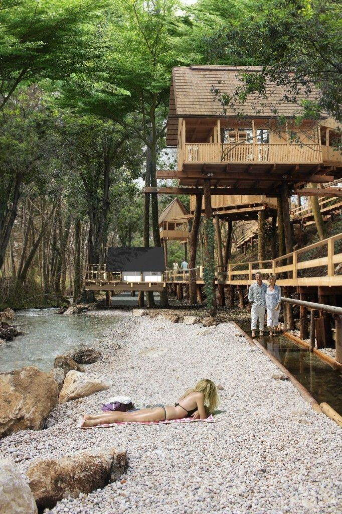 Garden Village Resort Bled in Slovenia is scheduled to open in June 2014 with tree houses, safari tents and tents placed on pier pilings over a stream.