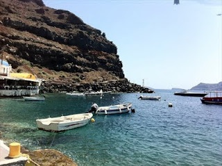 """Santorini: Eat at Katina.  """"The Greece I've been dreaming of.""""  Casual restaurant on the water with fresh seafood.  You can choose your catch coming straight off the boats.  Located in the fishing village of Ammoudi, located 214 steps below the town of Oia."""