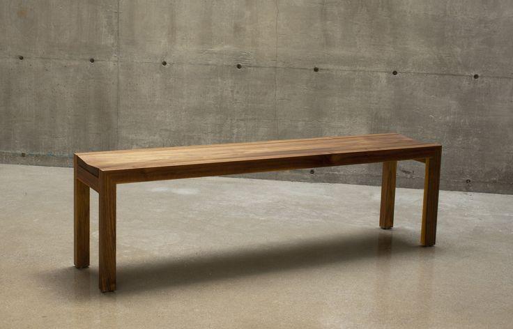 C 109 bench in walnut.   Angled seat for additonal comfort / Banc C 109 en noyer.   Siège en biais pour comfort additionnel