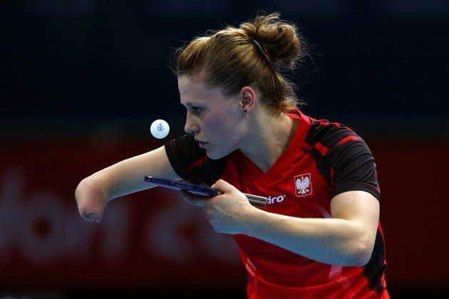 Polish table tennis player Natalia Partyka, born without a right hand and forearm. One of very few athletes who competed both at the Olympics and Paralympics