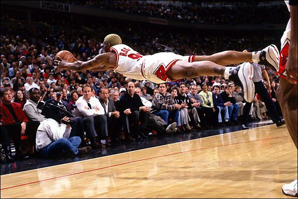 Dennis Rodman diving for the ball. Great rebounder, tough player.