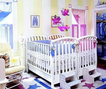 Boy-Girl Style - A backdrop of yellow stripes plays host to two sides of this shared space -- each sporting a coordinating hue of either blue or pink. A two-tone rug underfoot also unites these two colors, making a perfect room for a boy and a girl.