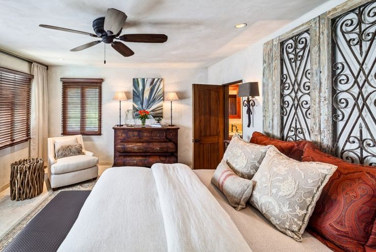 Liking the headboard and blinds in this room.  Make Your Room More Cheerful With Unique Headboard: Unique Headboard And Decorative Pillows In Mediterranean Bedroom Ideas Décor With Accent Table And Wood Panel Door Also Beige Sofa Plus Ceiling Fan And Wall Decor ~ idobrich.com Home Accessories Inspiration