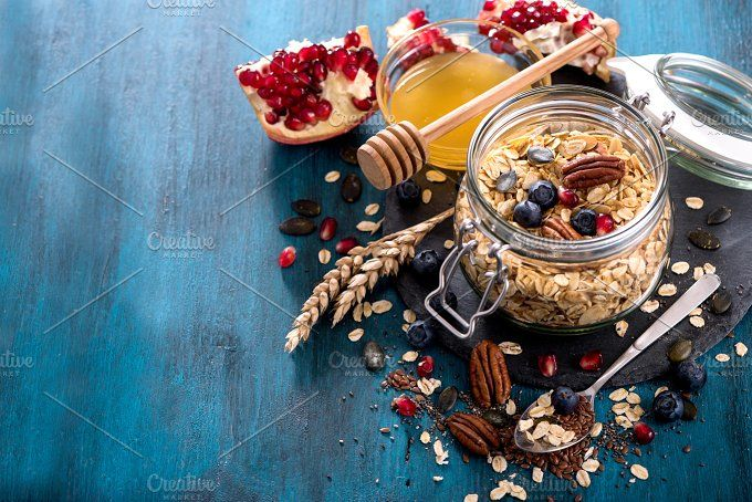 Granola with berries, nuts and seeds, healthy breakfast and diet concept, vitamin snack copy space