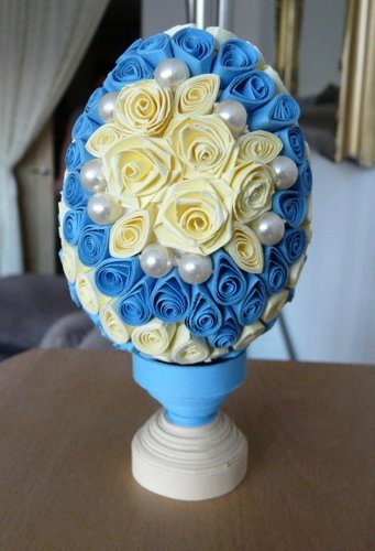 Blue and yellow quilled egg